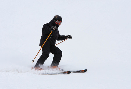 Skiers ride the slopes in the mountains, Christmas holidays Stock Photo