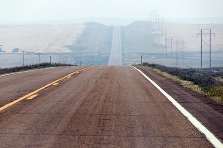 A hazy, hilly road in North Dakota.