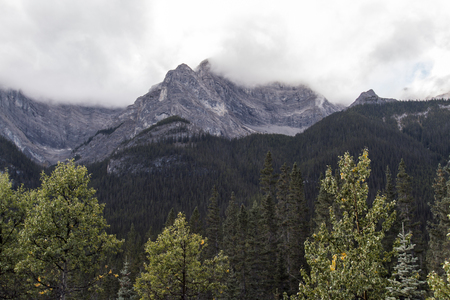 Clouds touching the peaks of mountains in Kananaskis country. Stock fotó