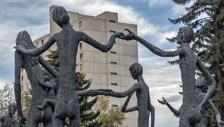 Calgary, AlbertaCanada – August 30, 2015: A rear view of Family of Man, build by Mario Hubert Armengol, outside the Calgary Education Centre in Calgary, Alberta.