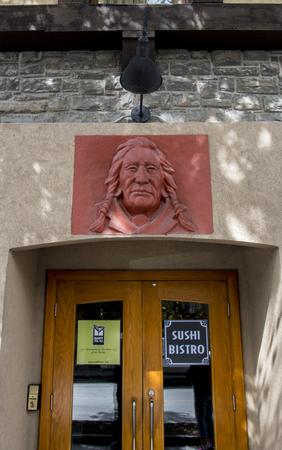 Banff, AlbertaCanada – August 31, 2015: An indigenous indian design on a building in Banff, Alberta. Sajtókép
