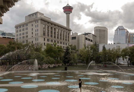 Calgary, AlbertaCanada – August 30, 2015: The  Plaza (with the Calgary Tower visible) on a cloudy day in Calgary, Alberta.