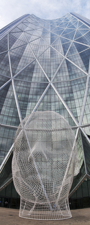 Calgary, AlbertaCanada – August 30, 2015: Wonderland, a sculpture created by Barcelona-based designer Jaume Plensa, sits in from of The Bow in Calgary, Alberta. Editorial