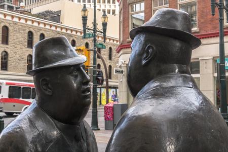 Calgary, AlbertaCanada – August 30, 2015: The Conversation sculpted by William Hodd McElcheran, viewed up close in Calgary, Alberta.