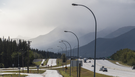 A view of the haze obscured mountains near Harvie Heights in Alberta, Canada. Stock fotó