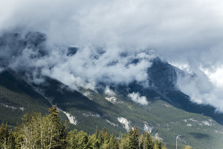 Clouds hanging low and obscuring the mountains in Banff National Park, Alberta, Canada.