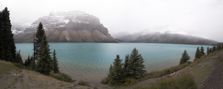 A shot of the beautiful Canadian Rockies along the glacier-blue waters of the Bow River.