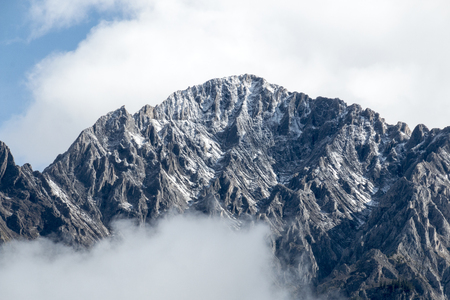 The Amazing textures of a mountain range shrouded in clouds in Banff National Park, Alberta, Canada. Stock Photo