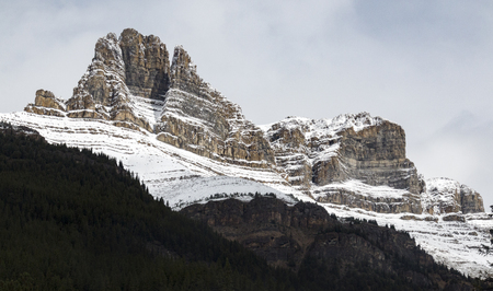 Stoic and snow-covered rock formations in Banff National Park, Alberta, Canada.