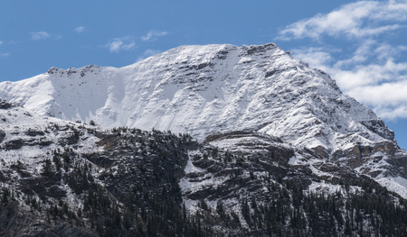 Blue skies over an immense mountain in Jasper National Park in Alberta, Canada.