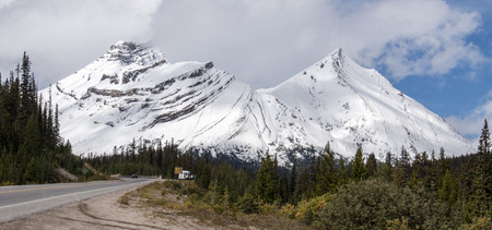 A closer view of sister peaks covered with snow in Jasper National Park, Alberta, Canada.