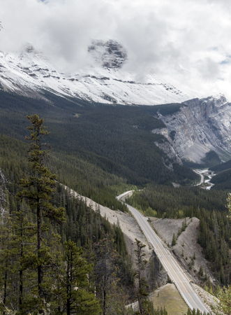 The view of mountains and a road viewed from a high vantage point in Banff National Park in Alberta, Canada.