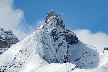 A solitary, snow-covered mountain peak in Jasper National Park, Alberta, Canada.