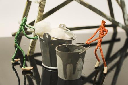 figurines: two wire figurines do maintenance Stock Photo