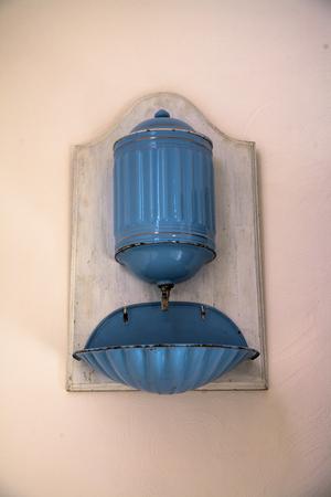 washbasin: old wash-basin on the wall