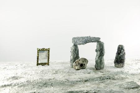 dollhouse: miniature of stonehange on white background