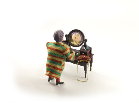 dollhouse: fat lady in striped dress looking in the mirror