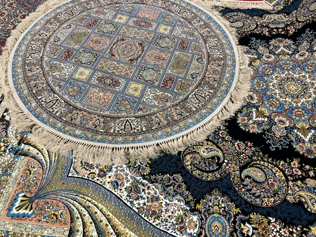 carpets woven by hand with colorful patterns of beautiful hard work and a lot of small details Фото со стока