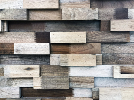 decorative wall of wooden rectangles made of wood of different colors Stock fotó - 99602415
