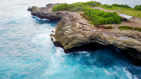 cliff and rocks in Indonesia on the island of penida, waves beating on the rocks Stock Photo