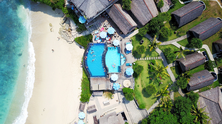 top view of the sandy beach ocean and pool near the cafe on the island of Penida in Indonesia Stock Photo