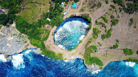 Broken beach on the island of Penida in Indonesia, the rocks and the ocean Stock Photo
