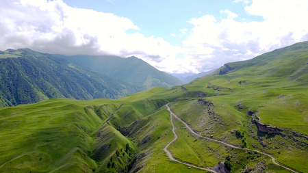 photo from the height of hills and mountains, narrow paths on the cliffs, cloudy sky, Kabardino-Balkaria Stock Photo