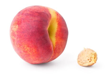 Peach and pit isolated on white background