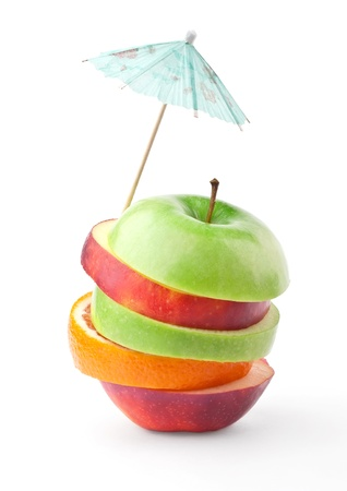 Layers of apples and oranges under umbrella isolated on white background