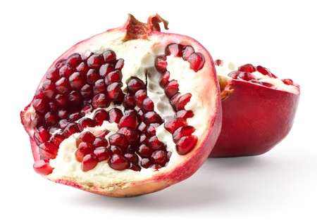 Two parts of pomegranate isolated on white background photo
