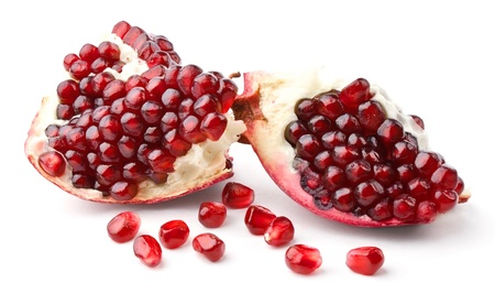 Part of pomegranate and seeds isolated on white background photo