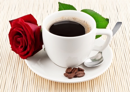 red taste: Cup of coffee and red rose on textured background Stock Photo