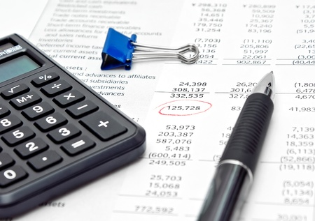 Financial report with calculator and pen Stock Photo