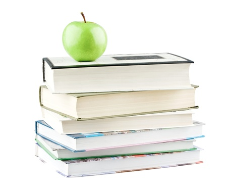 Green apple on textbooks on white background Stock Photo