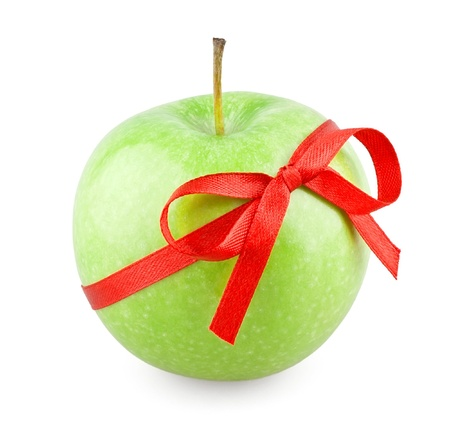 Green apple with a bow on white background