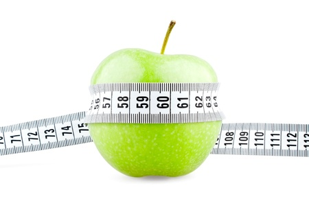 Green apple tied with meter on white background 版權商用圖片