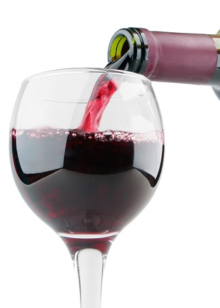 merlot: Filling glass with red wine on white background