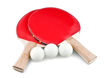 Crossed tennis rackets and three balls on white background Stock Photo