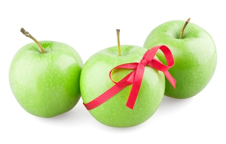 Green apples with a bow on white background