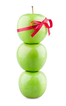Tower of apples with ribbon on white background photo