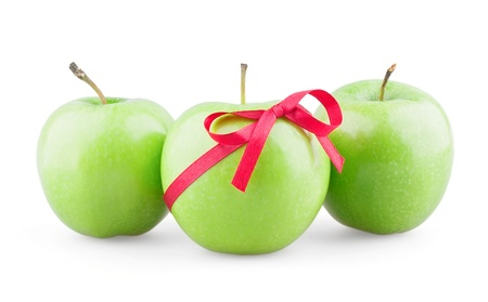 Three apples with ribbon on white background photo