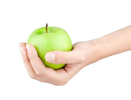 Green apple in female hand on white background photo