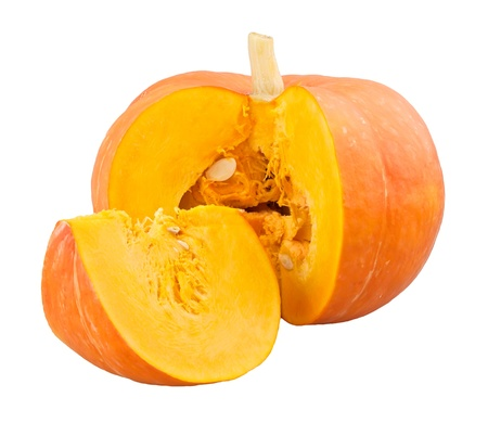Sliced pumpkin with seeds on white background photo