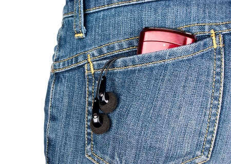 portable mp3 player: Headphones and player in the back pocket of jeans on white background