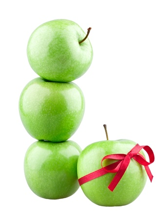 Tower of apples and apple gift on white background photo