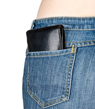 Wallet in back pocket of jeans on white background