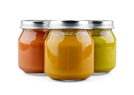 Three jars of baby food on white background photo