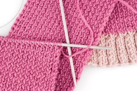 Knitting scarf on white background Stock Photo