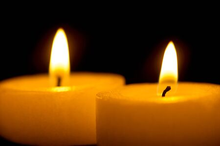 candles in dark: Burning candles in the dark Stock Photo