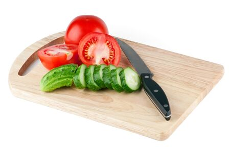 Cutting board with vegetables on white background photo